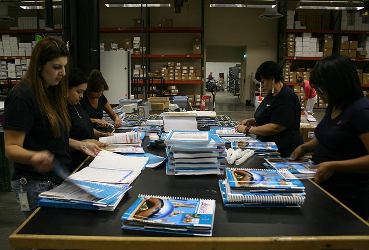 Hand assembling P-Coil books